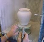 Spraying glaze on pottery